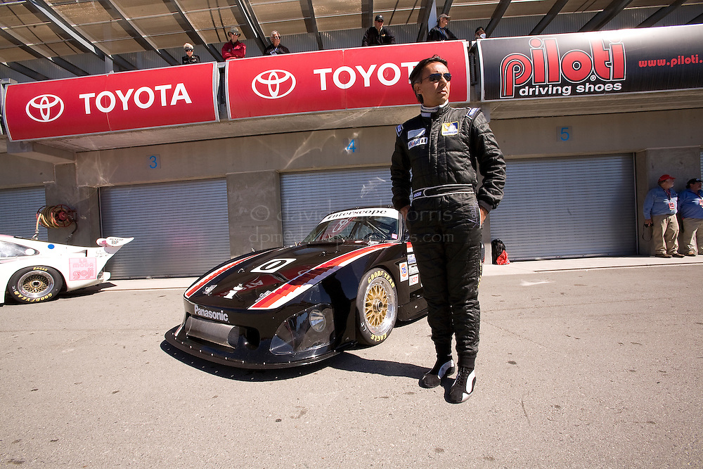 MONTEREY, CA - AUGUST 19: Alain Li stands in front of his his 1980 Porsche 935 before racing in the Monterey Historic Automobile Races at the Mazda Raceway Laguna Seca on August 19, 2007 in Monterey, California.  (Photo by David Paul Morris)
