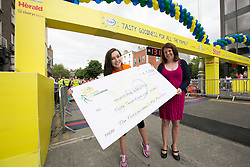 Repro Free: 02/06/2014 Dublin <br /> Amelia Marley (18) from Donegal is pictured with Suzanne O&rsquo;Hara, Flora Marketing Manager as Flora present Headstrong, the &lsquo;Flora Taste Team Fundraising &lsquo; winner with a cheque for &euro;1000 at the start of the Flora Women&rsquo;s Mini Marathon. Picture Andres Poveda