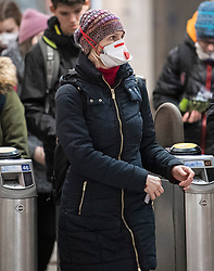 © Licensed to London News Pictures. 09/03/2020. London, UK. A member of the public wearing a medical mask at Westminster Underground station in central London. New cases of the COVID-19 strain of Coronavirus are being reported daily as the government outlines it's plans for controlling the outbreak. Photo credit: Ben Cawthra/LNP