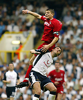 Photo: Chris Ratcliffe.<br />Tottenham v Liverpool. The Barclays Premiership.<br />10/09/2005.<br />Steven Gerrard climbs over Michael Brown of Spurs but injures himself in the process