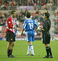 Photo. Andrew Unwin<br /> Sunderland v Wigan Athletic, Nationwide League Division One, Stadium of Light, Sunderland 02/12/2003.<br /> Sunderland's Julio Arca (l) is given a second yellow card, and then a red, by referee, Mr A Kaye, after diving over the challenge of Wigan's Jimmy Bullard.