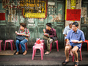 11 SEPTEMBER 2013 - BANGKOK, THAILAND:  People eat at a street side curry stand in the Chinatown section of Bangkok. Even by Bangkok standards, this is an informal place, there are no tables, just stools. It is one of the more popular street side food stalls in Chinatown, there is usually a line of people waiting to buy the fresh made curries. Thailand in general, and Bangkok in particular, has a vibrant tradition of street food and eating on the run. In recent years, Bangkok's street food has become something of an international landmark and is being written about in glossy travel magazines and in the pages of the New York Times.        PHOTO BY JACK KURTZ