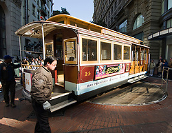 California, San Francisco: Turning the Cable Car around at the foot of Powell Street..Photo #: 4-casanf79254.Photo © Lee Foster 2008