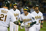 Oakland Athletics designated hitter Ryon Healy (25) celebrates after hitting a three-run home run against the Miami Marlins at Oakland Coliseum in Oakland, Calif., on May 23, 2017. (Stan Olszewski/Special to S.F. Examiner)