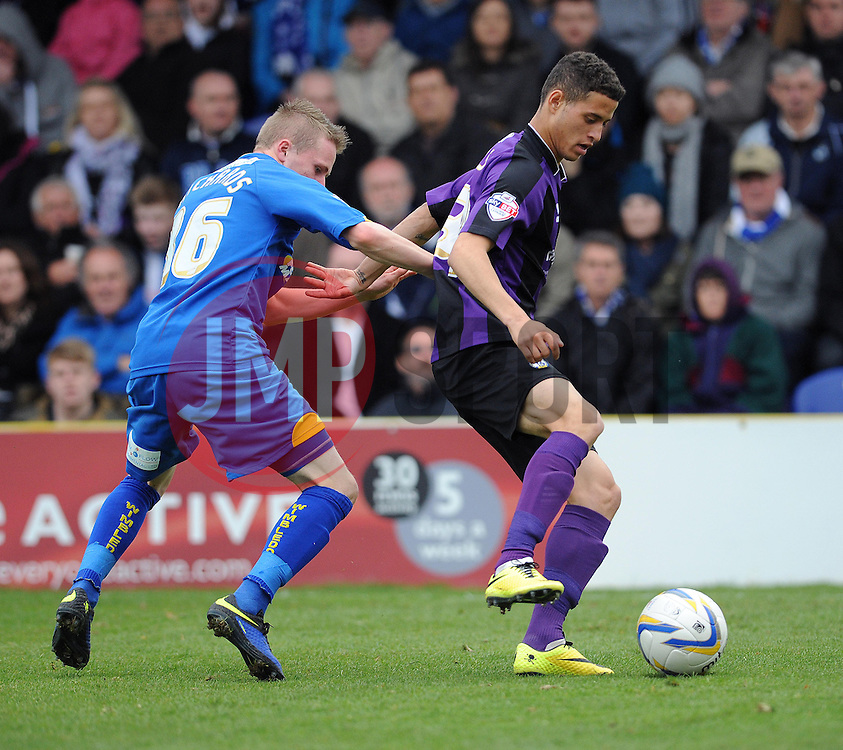 Bristol Rovers' Alefe Santos holds the ball up from AFC Wimbledon's Tom Richards - Photo mandatory by-line: Dougie Allward/JMP - Mobile: 07966 386802 05/04/2014 - SPORT - FOOTBALL - Kingston upon Thames - Kingsmeadow - AFC Wimbledon v Bristol Rovers - Sky Bet League Two