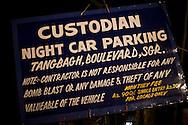 A signboard at the entrance of a Srinagar car parking bay, Kashmir, India..Pre-season Jeep road trip from Delhi to Amritsar, Srinagar, Kargil, Lamayuru, Leh, Khardung La, Tso Moriri and back to Delhi in May 2010. Photo by Suzanne Lee.