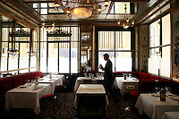 setting up tables and polishing glasses at the Restaurant, Led Grand Vefour, Paris - photograph by Owen Franken