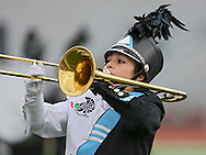 Sonya Peters eyes the drum major as she plays the trombone during the Trojan Marching Band from South Tama Couty High School's performance at the State Marching Band Festival at Kingston Stadium in Cedar Rapids on Saturday October 6, 2012. Members of the band were wearing ribbons for Sabrina Betz and Ian McFate.