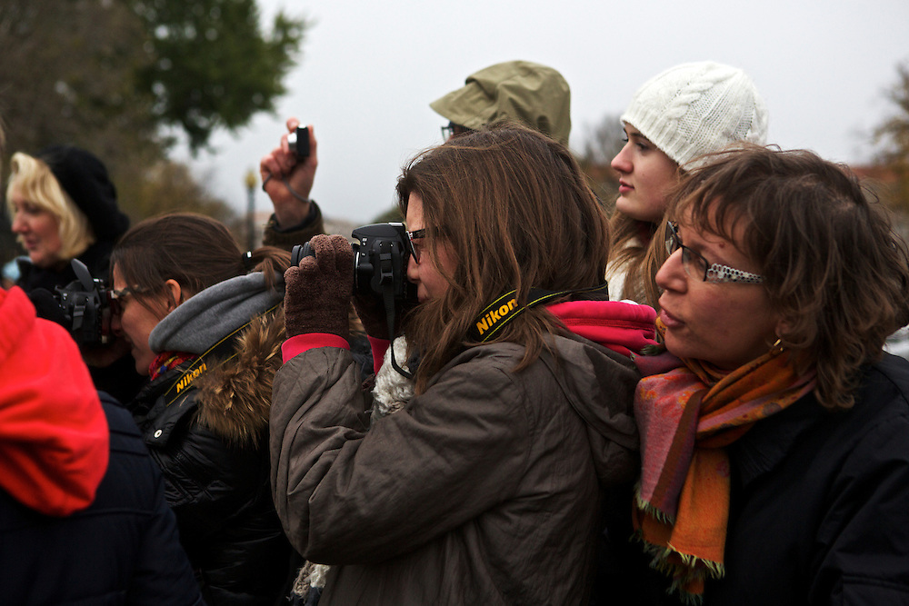 """A group from Lille, France, take photos in front of the White House on Wednesday, Nov. 7, 2012 in Washington, D.C. """"For Europe it's very good,"""" said Christelle Dumortier of President Barack Obama's win of the 2012 election. """"We were waiting for his victory."""" The group spent Wednesday in Washington, D.C. during their trip to the United States."""
