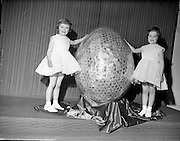 Chocolate manufacturers Urney present a giant Easter Egg to the ISPCC..23.02.1961 The 2 lovely young girls Mary and Barbara (Bobby) are daughters of Mr T Headon former Irish International Rugby player 1938/9