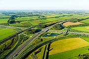 Nederland, Gelderland, Gemeente Zaltbommel, 23-08-2016; verkeersknooppunt Deil, A2 en A15  (vlnr) - parallel A2 de Betuweroute. Klaverturbineknooppunt.<br /> Deil junction, main motorway A15 Rotterdam Harbour - Germany crossing A2 to the South.<br /> <br /> aerial photo (additional fee required); <br /> luchtfoto (toeslag op standard tarieven);<br /> copyright foto/photo Siebe Swart