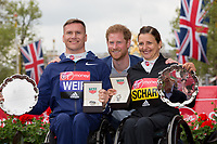 David Weir GBR and Manuela Schar SUI pose with HRH Prince Henry of Wales (Prince Harry) following their victories in the Elite Wheelchair races. The Virgin Money London Marathon, 23rd April 2017.<br /> <br /> Photo: Jed Leicester for Virgin Money London Marathon<br /> <br /> For further information: media@londonmarathonevents.co.uk