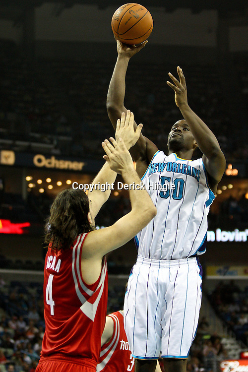 April 6, 2011; New Orleans, LA, USA; New Orleans Hornets center Emeka Okafor (50) shoots over Houston Rockets power forward Luis Scola (4) during the first half at the New Orleans Arena.   Mandatory Credit: Derick E. Hingle-US PRESSWIRE