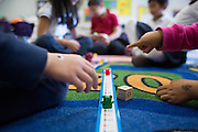 Students play a game to learn how to add and subtract with number tape and die in the transitional kindergarten class at Rose Elementary School in Milpitas, California, on April 5, 2013. (Stan Olszewski/SOSKIphoto)