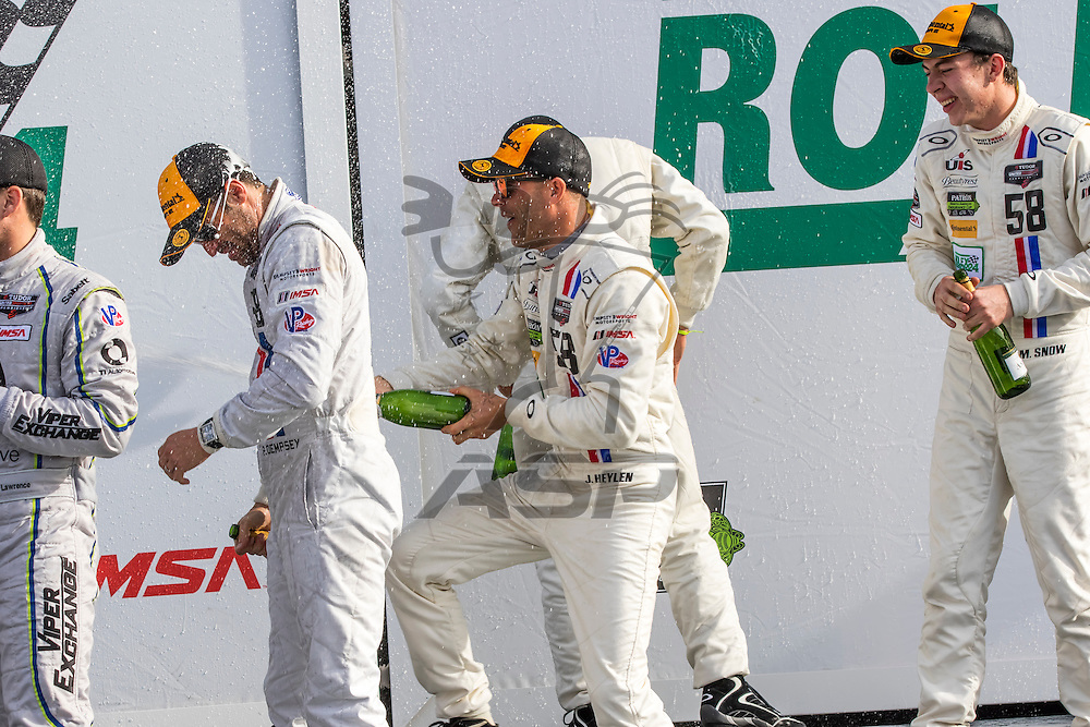 Daytona Beach, FL - Jan 25, 2015:  Patrick Dempsey (58) and his team celebrate after winning their division at the Rolex 24 at Daytona International Speedway in Daytona Beach, FL.