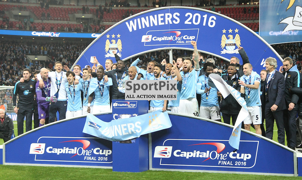 Manchester City celebrate their cup final victory on penalties over Liverpool