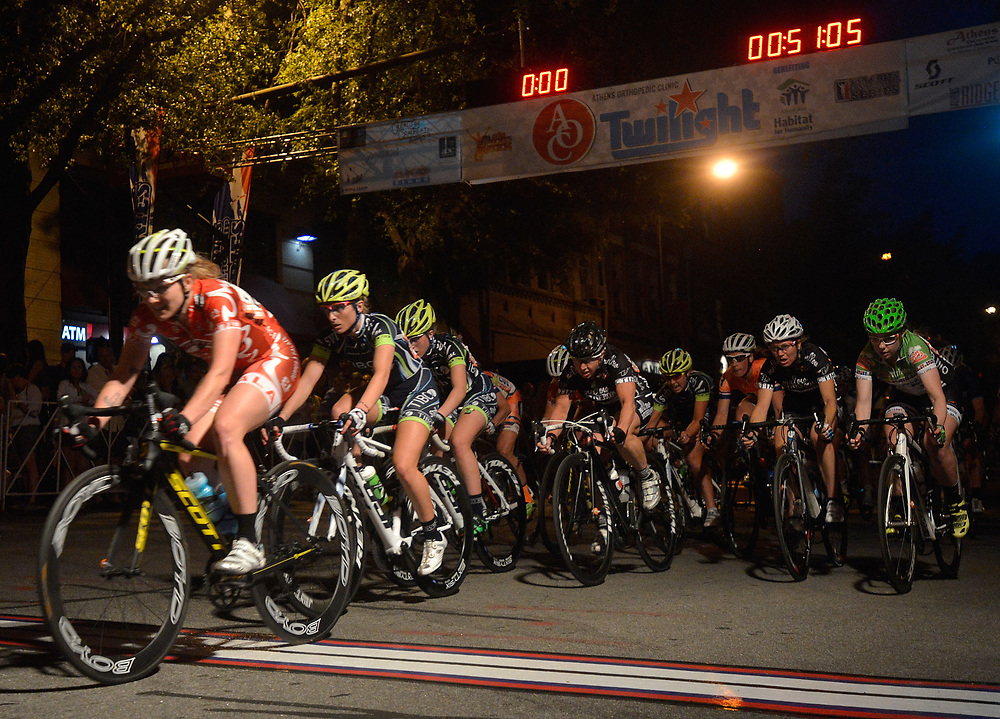 A peloton passes across the finish line during the Women's Twilight Criterium on Saturday, April 26, 2014 in downtown Athens, Ga.