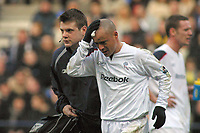 Photo: Paul Thomas.<br />Bolton Wanderers v Manchester City. The Barclays Premiership. 21/01/2006.<br />Bolton's Stelios (R) leaves the field to get treatment after banging heads with Richard Dunne.