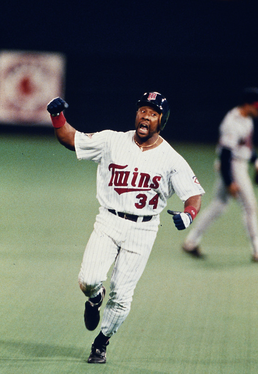 MINNEAPOLIS, MN-OCTOBER 26: MLB Hall of Fame outfielder Kirby Puckett rounds the bases after hitting a game winning, walk off home run in the eleven inning off of Charlie Leibrant to win Game 6 of the 1991 World Series against the Atlanta Braves at The Metrodome on October 26, 1991 in Minneapolis, Minnesota. The Twins won 4-3 and tied the series 3-3.  (Photo by Ron Vesely)