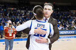 Kentucky head coach Matthew Mitchell, right, gives guard Makayla Epps a hug after the win over Tennessee, 64-63, Monday, Jan. 25, 2016 at Memorial Coliseum in Lexington .