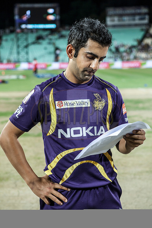 Gautam Gambhir reading his team list just before toss during match 15 of the the Indian Premier League ( IPL) 2012  between The Kolkata Knight Riders and The Rajasthan Royals held at the Eden Gardens Stadium in Kolkata on the 13th April 2012..Photo by Saikat Das/IPL/SPORTZPICS