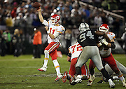 Kansas City Chiefs quarterback Alex Smith (11) throws a 30 yard fourth quarter touchdown pass that ties the game at 17-17 during the NFL week 12 regular season football game against the Oakland Raiders on Thursday, Nov. 20, 2014 in Oakland, Calif. The Raiders won their first game of the season 24-20. ©Paul Anthony Spinelli