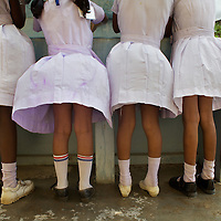 "Grade 4 Childrens Brigade students washing their hands in UNICEF-supplied sinks at the K.M. Vivekanana Vidalayam school in Kalmunai, Ampara Dist. ..The Kalmunai community was tsunami affected and for six months the school grounds became an IDP camp. The school continued teaching during this time in a local temple. The school is known as a ""Child Friendly School"". Unicef has provided sanitary facilities: boys and girls toilets and hand washing area. Immediately after the tsunami, Unicef supplied books to the school. Unicef has trained teachers in child friendly education and in the establishment of a Children's Brigade. Children's Brigades are a means of promoting hygiene practice in pupils and encouraging them to disseminate messages of hygiene practice and awareness in the wider community...Photo: Tom Pietrasik.Ampara District, Sri Lanka.September 29th 2009"
