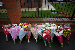 © Licensed to London News Pictures . 13/12/2015 . Bolton , UK . Flowers left at the scene . Greater Manchester Police report they are conducting a murder investigation after a man was stabbed on Brightmeadow Place in Breightmet in Bolton . Photo credit : Joel Goodman/LNP