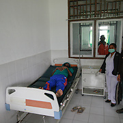 Medical check up of a patient in Wamena hospital