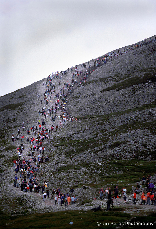 IRELAND CO. MAYO CORAGH PATRICK JUL99 - Pilgrims ascend Croagh Patrick mountain in their thousands. Around 25,000 people, some of which are bare-footed, participate in this pilgrimage to the top of Croagh Patick mountain on the last Sunday of July from where in 441 A.D. St. Patrick supposedly sent Ireland's reptiles to their doom. ..jre/Photo by Jiri Rezac..© Jiri Rezac 1999..Contact: +44 (0) 7050 110 417.Mobile: +44 (0) 7801 337 683.Office: +44 (0) 20 8968 9635..Email: jiri@jirirezac.com.Web: www.jirirezac.com..© All images Jiri Rezac 1999 - All rights reserved.
