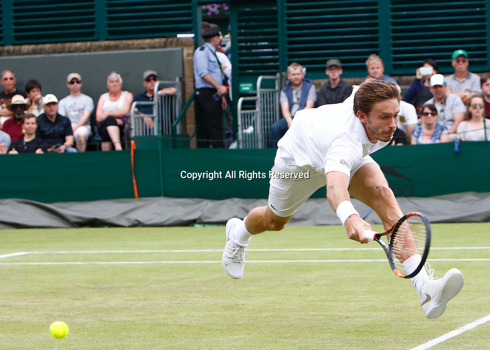 04.07.2016. All England Lawn Tennis and Croquet Club, London, England. The Wimbledon Tennis Championships Day 8.  Nicolas Mahut (FRA) is beaten by the passing shot of Sam Querry (USA).