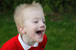 Portrait of a young boy laughing,