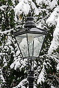 Snow covered street lamp in North London, England, United Kingdom