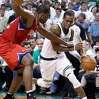26 May 2012: Boston Celtics point guard Rajon Rondo (9) use fouled by Philadelphia Sixers power forward Elton Brand (42) during the Boston Celtics 85-75 victory over the Philadelphia Sixer, in Game 7 of the Eastern Conference semifinals playoff series, at the TD Banknorth Garden, Boston, Massachusetts, USA.