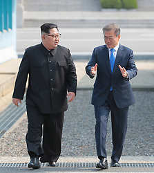 April 27, 2018 - Panmunjom, South Korea - South Korean President MOON JAE-IN meets North Korean leader (DPRK) KIM JONG UN, as he crosses the concrete step and the world's most heavily armed border to greet the South Korean President. particularly heightened tensions between Iran, Israel, and the US. (Credit Image: © Inter-Korean Press Corps via ZUMA Wire)