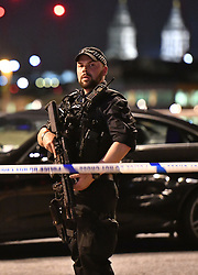 """Armed Police officer on London Bridge as police are dealing with a """"major incident"""" at London Bridge."""