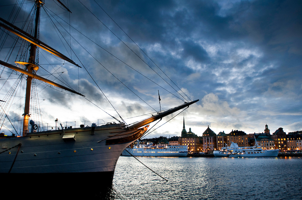 """View of Stockholm Old Town (Gamla Stan) from Skeppsholmen. The sail ship """"Af Chapman"""" that is now a hostel in the foreground"""