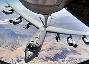 "Capt. ""Will"" (right) and Major ""Tom"" (left) pilot a lone B-52H Stratofortress bomber into a refueled position over Afghanistan, during a close air support mission for Coalition troops in contact with enemy forces. The  fuel will allow it to extend its time on station. To do this, the KC-135R/T Stratotanker ahead of it, will transfer fuel at about 16 gallons per second. They are deployed to the 20th Expetitionary Bomb Squadron, and from the 2nd Bomb Wing, Barksdale Air Force Base, La. (U.S. Air Force photo by Master Sgt. Lance Cheung)"