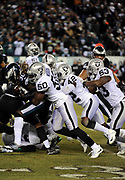 Dec 25, 2017; Philadelphia, PA, USA; Oakland Raiders linebacker Nicholas Morrow (50) makes a stop of Eagles running back Jay Ajayi (36) during a NFL football game at Lincoln Financial Field. The Eagles defeated the Raiders 19-10. Photo by Reuben Canales