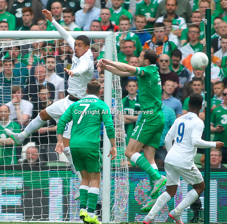 07.06.2015.  Dublin, Ireland. International Football Friendly. Republic of Ireland versus England. Chris Smalling (England) and John O'Shea (Rep. of Ireland) challenge for the ball as Aiden McGeady (Rep. of Ireland) and Raheem Sterling (England) look on.