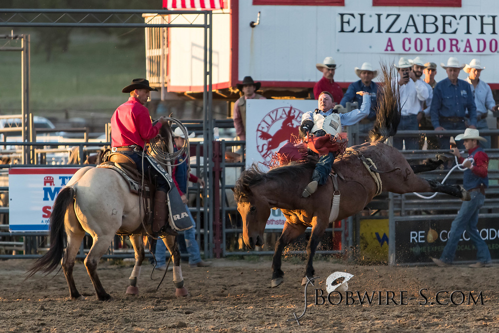 Bareback bronc rider Bill Tutor rides his reride bronc in the second performance of the Elizabeth Stampede on Saturday, June 2, 2018.