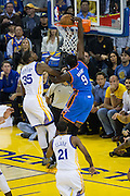Oklahoma City Thunder forward Jerami Grant (9) dunks the ball over Golden State Warriors forward Kevin Durant (35) at Oracle Arena in Oakland, Calif., on November 3, 2016. (Stan Olszewski/Special to S.F. Examiner)