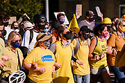 """28 JULY 2020 - DES MOINES, IOWA: Des Moines' """"Wall of Moms"""" march in front of Black Lives Matter protesters to the Governor's Mansion in Des Moines. About 150 supporters of Black Lives Matter marched from downtown to Des Moines to the Governor's Mansion. They were demanding that Iowa Governor Kim Reynolds restore the voting rights for felons who have completed their sentence. In June, Reynolds met with representatives of Black Lives Matter and promised to sign an executive order to restore voting rights, but she hasn't said anything more about it in six weeks. Iowa is now the only state in the US that permanently strips felons of their voting rights. That means 60,000 people in Iowa can't vote.    PHOTO BY JACK KURTZ"""
