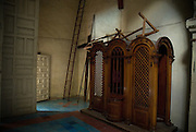 Queretaro, Mexico, August , 2006-Confessional and ladder inside the Convento de La Cruz interior.
