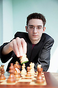 Lugano, il campione scacchista Fabiano Caruana. Fabiano Caruana was born on July 30, 1992 in Miami, Florida of an Italian-American father and an Italian mother. At the age of 4 his family relocated from Miami, Florida to Park Slope, Brooklyn. Coincidentally, this was the same neighborhood where Bobby Fischer lived during his youth. At age 5, his chess talent was discovered in an after school chess program at Congregation Beth Elohim in Park Slope, Brooklyn. That same year he played his first tournament at the Polgar Chess Center in Queens, New York.<br /> <br /> Up to the age of twelve, he lived and played in the United States, occasionally traveling to Europe and South America for tournaments.<br /> <br /> His first chess coach, from age six to eight, was National Master Bruce Pandolfini, and from age eight to twelve he studied with Grandmaster Miron Sher. In 2004 at age twelve, he relocated with his family from Park Slope, Brooklyn to Madrid to pursue a professional chess career. He trained with International Master Boris Zlotnik in Madrid, and in 2007 he moved to Budapest to train with Grandmaster Alexander Chernin.<br /> <br /> At age fourteen Caruana became the youngest ever Grandmaster of both the United States and Italy (surpassing the record in the United States set by Grandmaster Hikaru Nakamura). He currently lives in Lugano Switzerland, and plays for Italy.