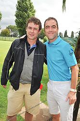 Left to right, DAN DAVIES and JAMES NESBITT at the Mini Masters Golf tournament in aid of LEUKA - London's celebrity golf tournament held at Duke's Meadow Golf Club, Dan Mason Drive, London W4 on 17th July 2009.