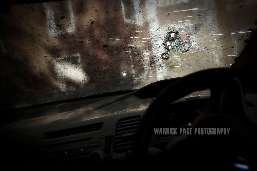 """LAHORE, PAKISTAN - MARCH 25: Bullet-holes are seen in the windshield of CIA contractor, Raymond Davis hire-car, on 25 March, 2011, in Lahore, Pakistan. Davis, CIA contractor and former US soldier, shot and killed 2 Pakistan men on January 27, he claimed were armed and attempting to car-jack him in a busy intersection of Lahore. In spite of his diplomatic immunity, Davis was arrested, imprisoned and charged with murder before he was released on March 16, when the US government paid """"blood-money"""" to the victims' families. The incident sparked a major diplomatic furore, widespread protests and the deterioration of US-Pak ties, which would only further weaken in the coming months when Osama bin Laden was killed by US Navy Seals hiding in the Pakistani military garrison town, Abbottabad.  (Photo by Warrick Page)"""