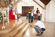 Pilgrims at the alter of the Church of the Divine Providence, where the Martyr Archbishop Oscar Romero was shot and killed in 1980.  El Salvador prepares for the beatification ceremony and mass announcing the beatification of Archbishop Oscar Romero. The Archbishop was slain at the alter of his Church of the Divine Providence by a right wing gunman in 1980. Oscar Arnulfo Romero y Galdamez became the fourth Archbishop of San Salvador, succeeding Luis Chavez, and spoke out against poverty, social injustice, assassinations and torture. Romero was assassinated while offering Mass on March 24, 1980.
