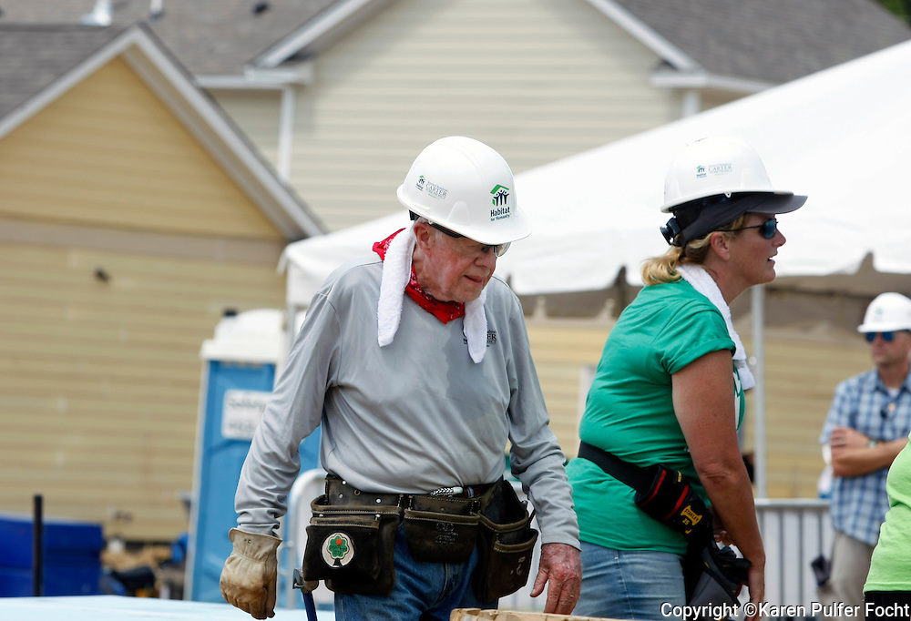 """JIMMY CARTER builds homes for the needy in Memphis on Tuesday for the 33rd annual Jimmy & Rosalynn Carter Work Project. Singer TRISHA YEARWOOD is at right. They're building 19 homes for Habitat for Humanity of Greater Memphis. The Former President Jimmy Carter said Monday that he put on """"a false, optimistic face"""" and that """"I just thought I had a few weeks to live.""""  He announced on Aug. 14, 2015, that he'd had a mass removed from his liver and that he'd been diagnosed with cancer which emerged that melanoma spots had reached his brain. He was onsite with hundreds of volunteers building new homes and a new neighborhood in needy North Memphis."""