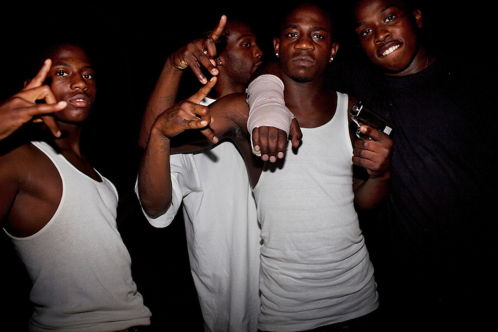 "(Second from L) Winky Williams, Lil' Mike, Demetrius ""Butta"" Anderson and a friend pose for a portrait on the streets of the Baptist Town neighborhood in Greenwood, Mississippi on the night of Thursday, September 23, 2010. Butta, whose arm was in a cast from a recent fight, was shot and killed a month later. He was 18-years-old."